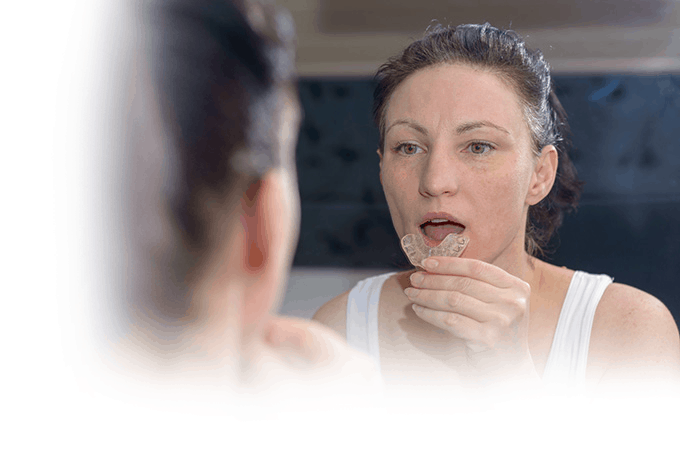 night guard stops teeth grinding and clenching effects on your teeth